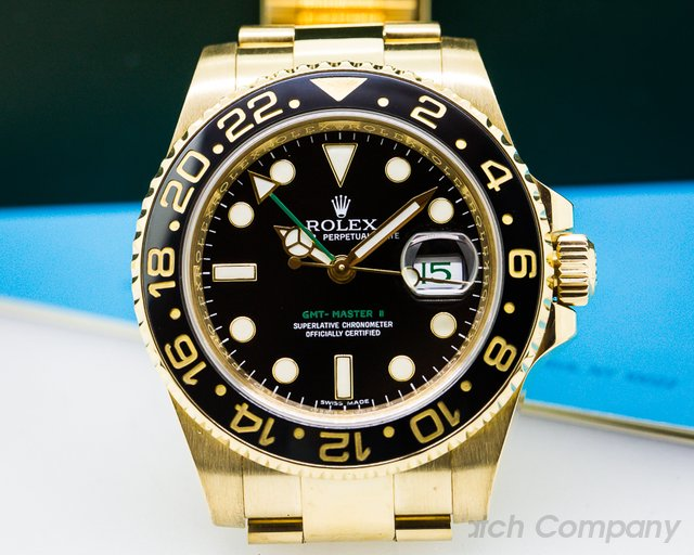 Rolex GMT Master II Black Dial 18K Yellow Gold / Bracelet