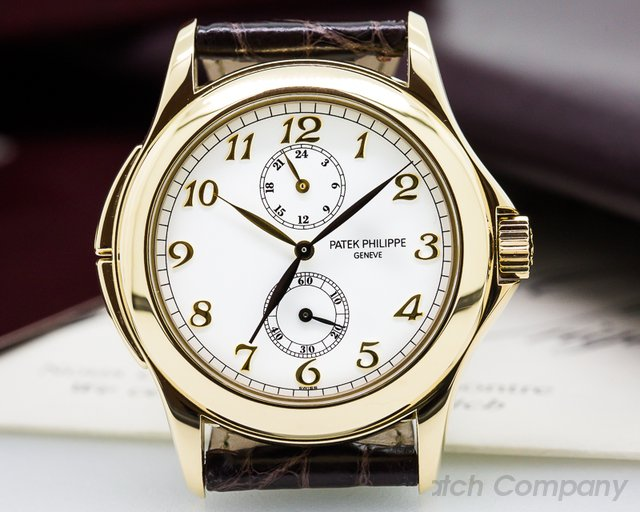 Patek Philippe Travel Time 18K Yellow Gold Manual Wind