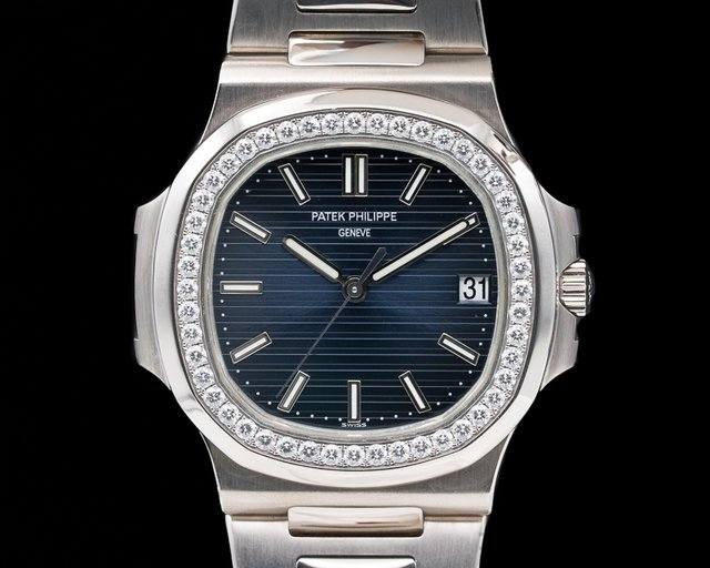 Patek Philippe 5713/1G-010 Nautilus White Gold / Diamond Bezel RARE