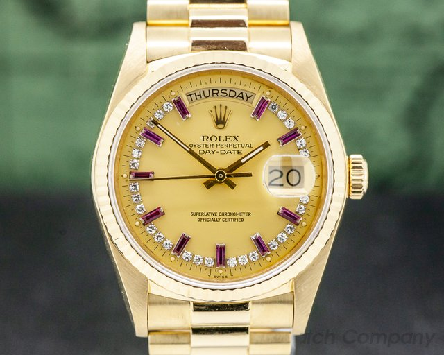 Rolex 18038  Day Date Diamond and Ruby String Dial Yellow Gold