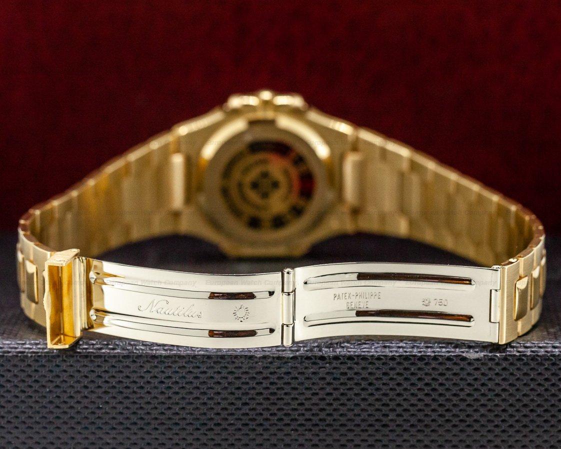Patek Philippe 3900/001 Nautilus Mid Size Quartz Yellow Gold Blue Dial UNPOLISHED