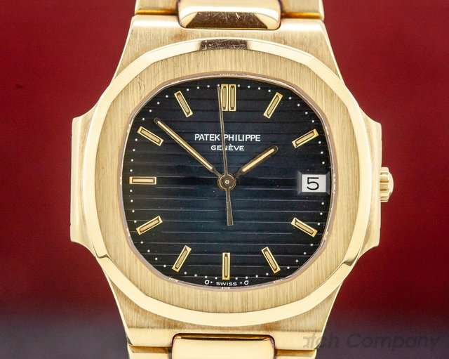 Patek Philippe 3900/001 Nautilus Mid Size Quartz Yellow Gold Blue Dial UNPOLISHED