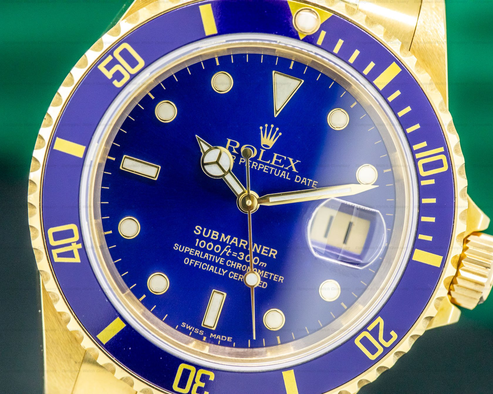 Rolex 16618 Rolex Submariner Blue Dial 18K Yellow Gold UNPOLISHED