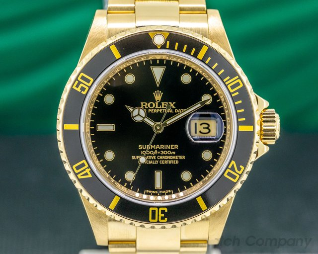 Rolex 16618 Rolex Submariner Black Dial 18K Yellow Gold MINT FULL SET