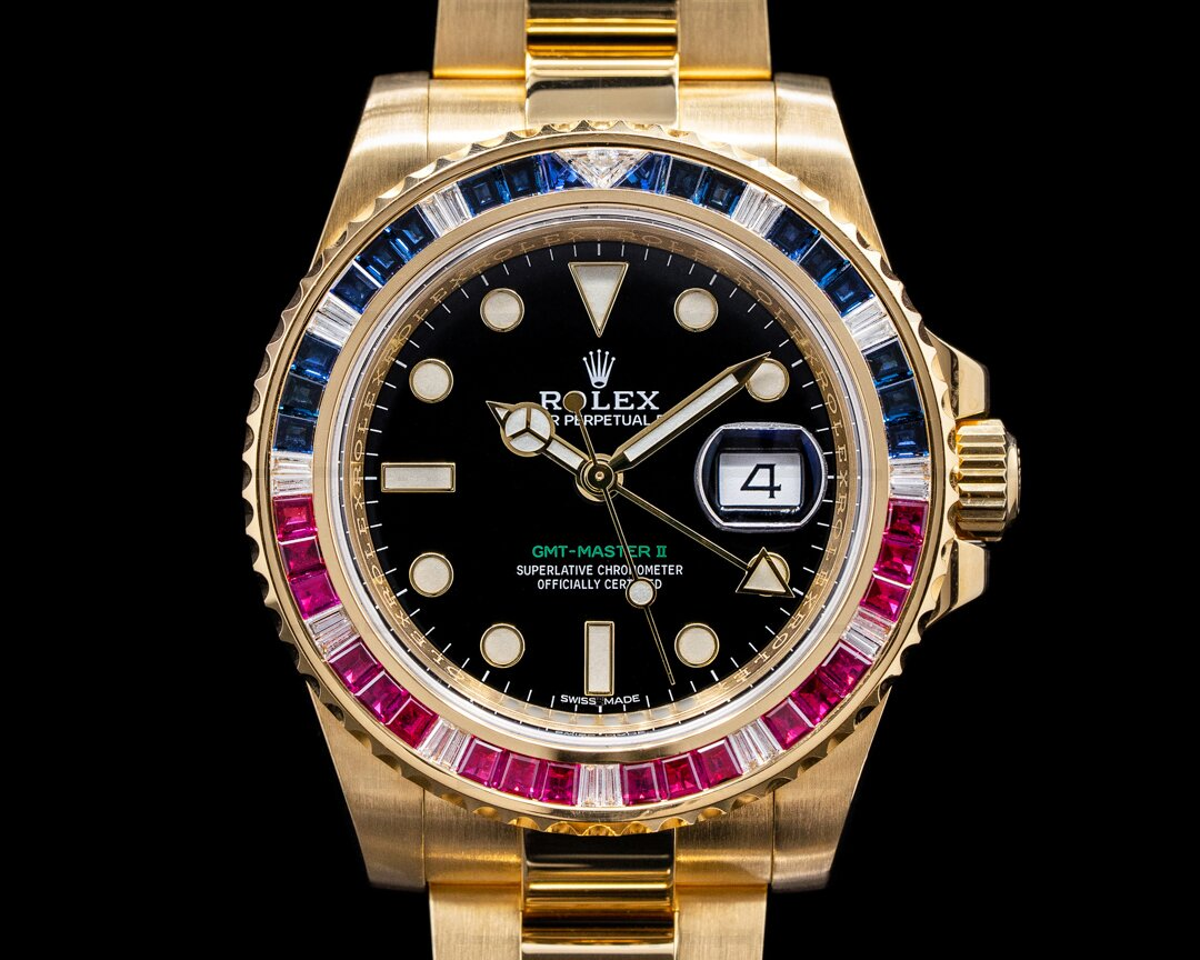 Rolex GMT Master II 116748SARU Yellow Gold Sapphire / Ruby Bezel Ref. 116748SARU